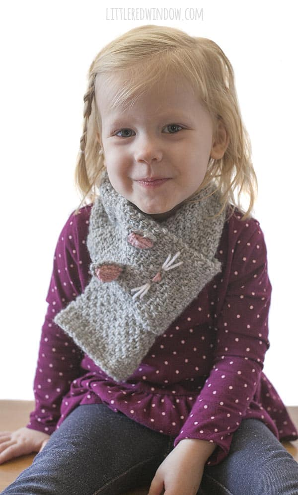Knit a cute Kitty Cat Scarf for your little one, this easy scarf knitting pattern is sure to be a hit!
