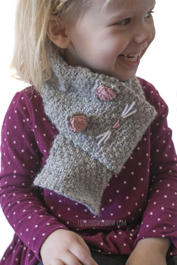 This little one loves her Kitty Cat Scarf knitting pattern!