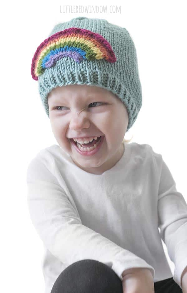 Knit this adorable and colorful Little Rainbow Hat knitting pattern for your little one!