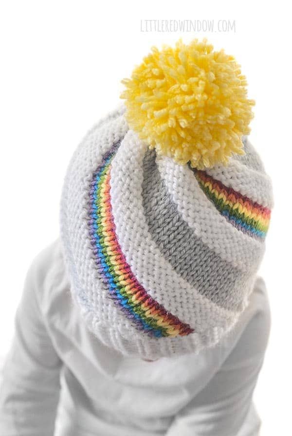 89674c6e10d The cute Rainbow Swirl Hat knitting pattern has colorful stripes that twist  up to the top