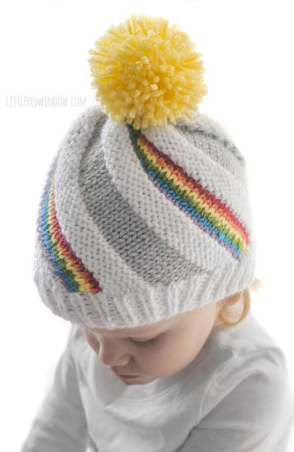 e5b15eac496 It s fun to see the rainbow stripes peeking out of the adorable Rainbow  Swirl Hat knitting