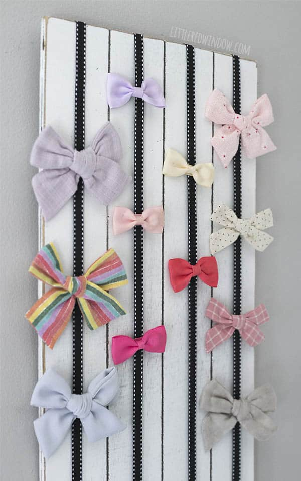 This quick and easy DIY Bow Holder is fun and adorable and will keep all of your bows and barrettes organized!