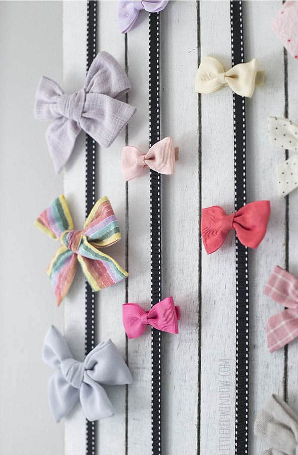 Cute hair bows need somewhere to live, this Easy DIY Bow Holder is the perfect way to display them!