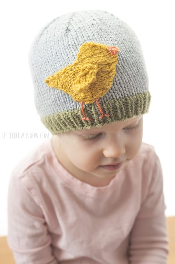 Cute little Easter Chick standing in the grassy brim of this adorable spring baby hat!