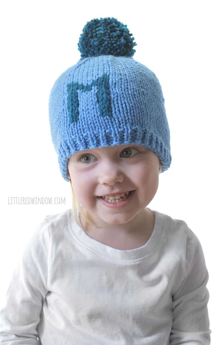 This little one likes her letter M Monogram Hat, knit with the easy Monogram Hat knitting pattern!
