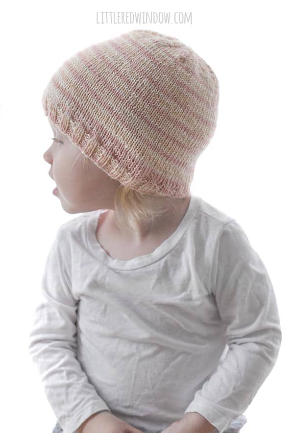 This easy knitting pattern uses sock weight (or fingering) yarn for this adorable baby and toddler hat!