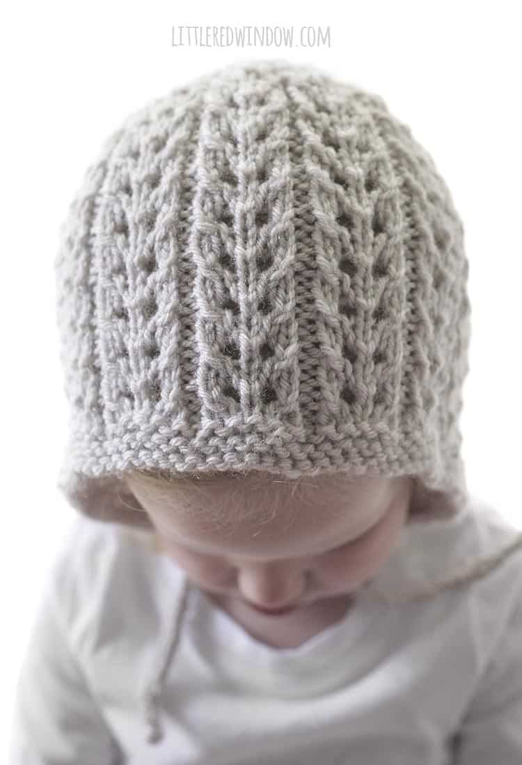 This easy ribbed lace knitting stitch makes the Flutter Lace Baby Bonnet knitting pattern so special and unique!