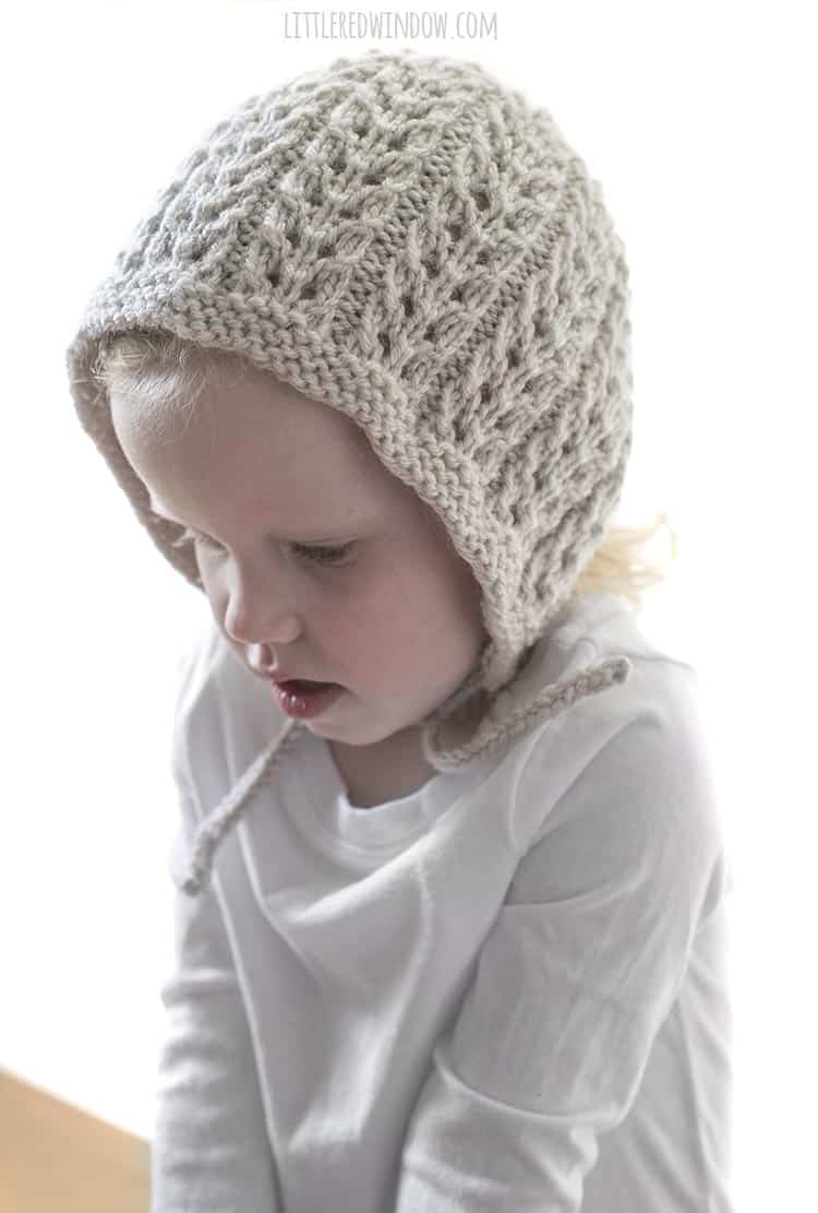Looking for a classic baby bonnet knitting pattern? The Flutter Lace Bonnet knitting pattern makes a GREAT baby shower gift idea!