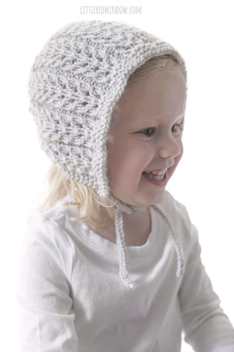 The Flutter Lace Bonnet knitting pattern is so sweet, perfect for your adorable baby or toddler!