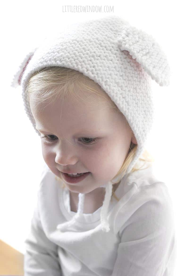 Closeup of little girl wearing lamb bonnet