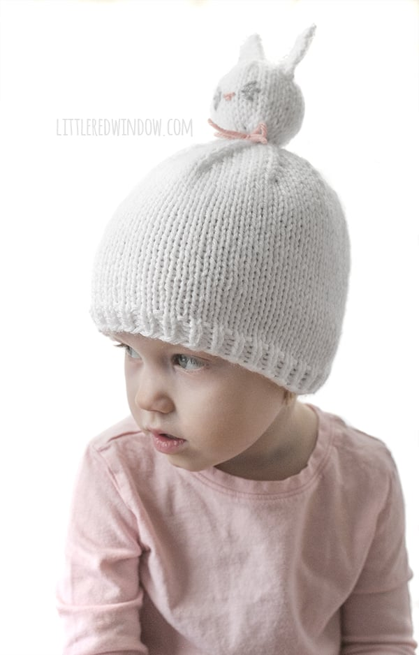 The Bunny Pom Pom Pet Hat knitting pattern is super fun to knit and your little one will love wearing it!