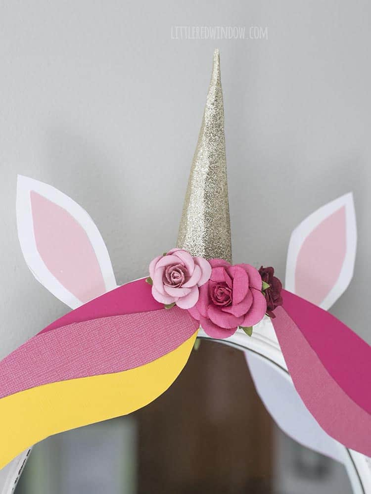 Add some cute little scrapbooking flowers to the top of your DIY unicorn mirror