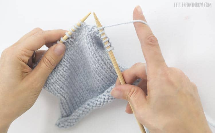 Drop the original stitch from the left knitting needle
