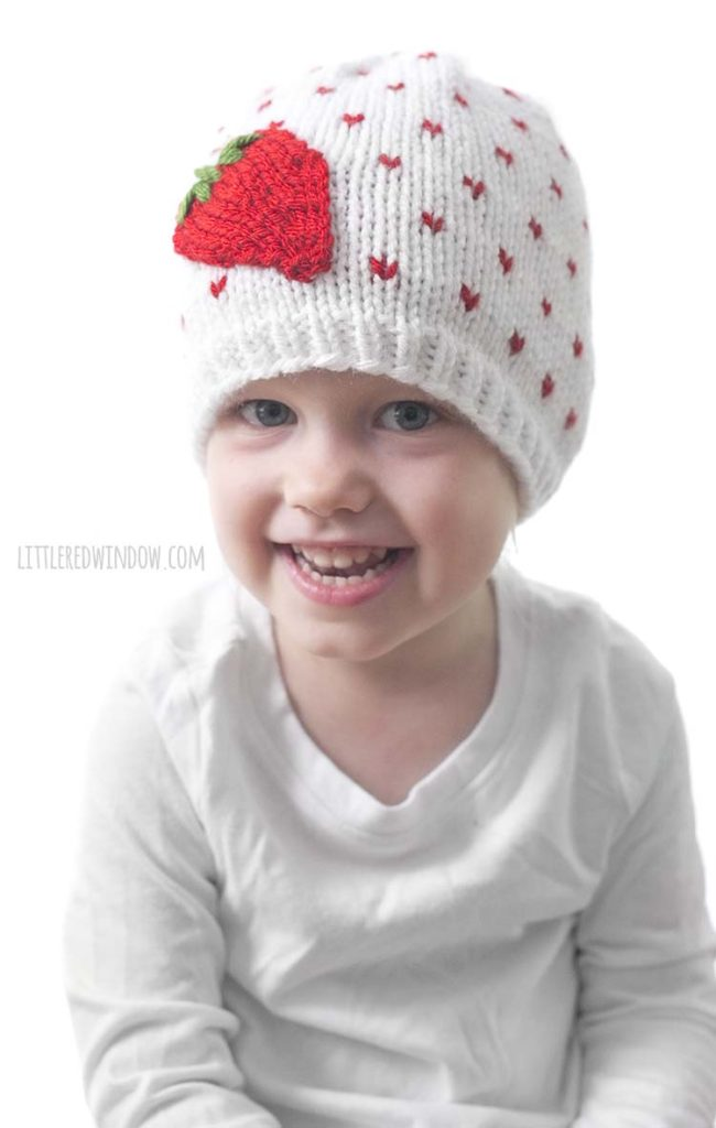 This little girl loves her Fresh Strawberry Hat, it's a fun and easy knitting pattern for babies and toddlers!