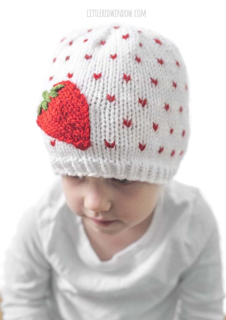 It's easy to embroider the leaves on top of the easy knit strawberry applique on the Fresh Strawberry Hat knitting pattern!