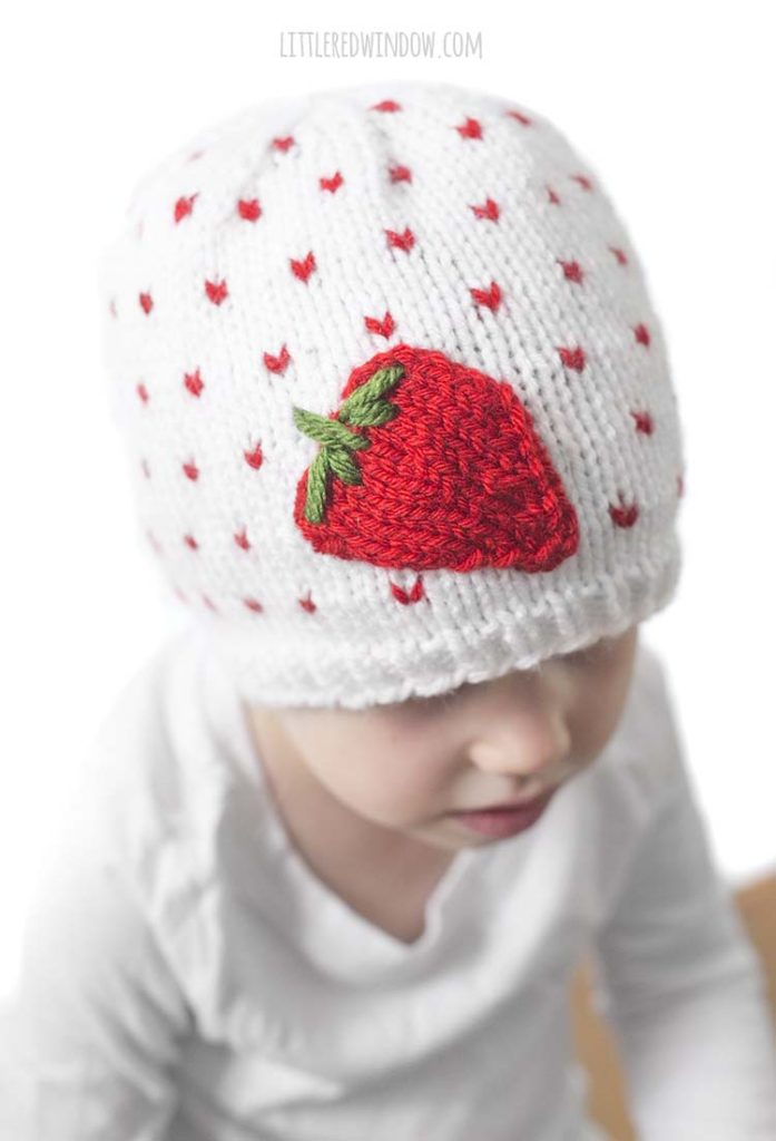 The Fresh Strawberry Hat knitting pattern has a cute little applique strawberry on the front!