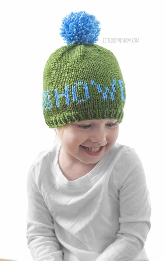 "Cute baby wearing a Greetings baby hat that says ""howdy""!"