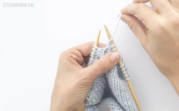 Bring the yarn forward between the knitting needles to do a yarn over