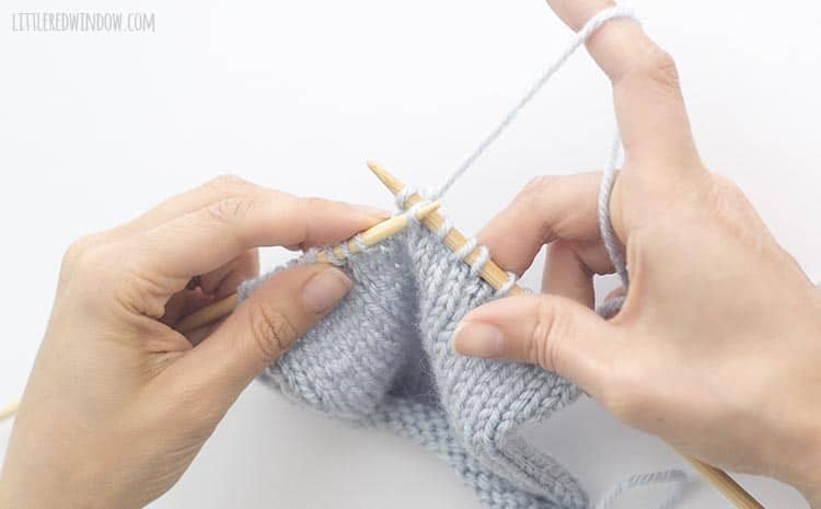 To complete the sk2p stitch, use the tip of the left knitting needle to lift the slipped stitch over the k2tog and off the right knitting needle