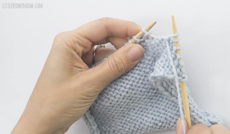 To finish a ptbl stitch, pull the yarn through the original stitch and drop the stitch from the left knitting needle