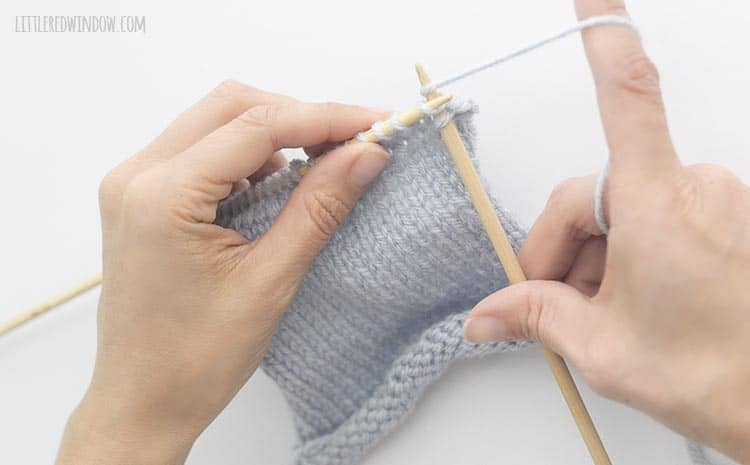 To bind of knit stitches, knit another stitch and then lift it up and over the first stitch on the right knitting needle