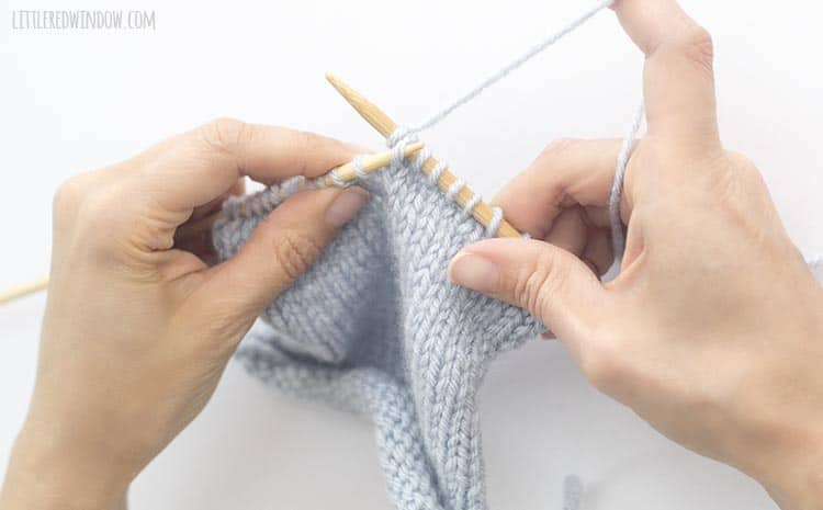 For an skp decrease in knitting, use the left needle to lift the first slipped stitch, up and over the knit stitch and off the right knitting needle