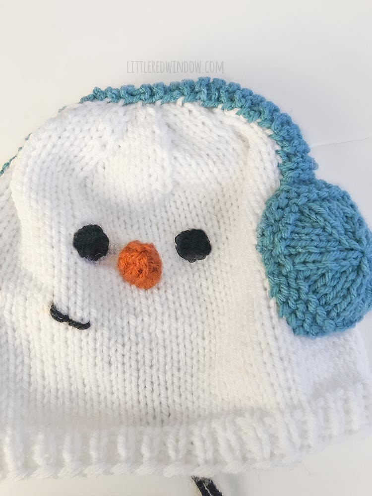 Use simple embroidery to add a smile to your snowman hat