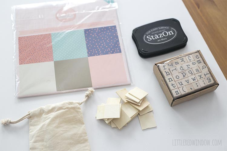 You only need a handful of supplies including scrapbook paper and stamps to make your own DIY travel matching game