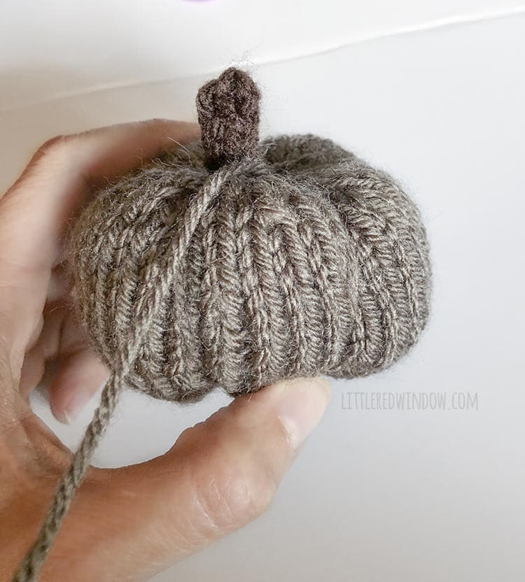 Use the yarn needle to shape your adorable knit little pumpkins!