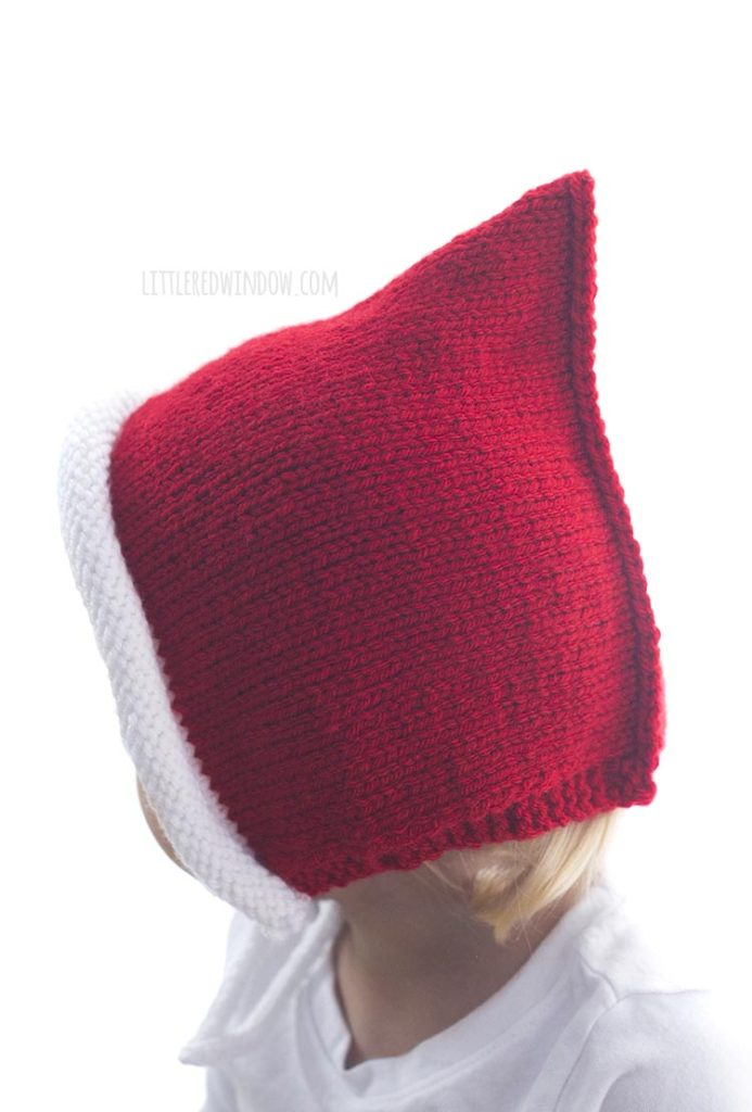 The Santa Pixie Bonnet knitting pattern is an easy knit flat baby bonnet pattern!