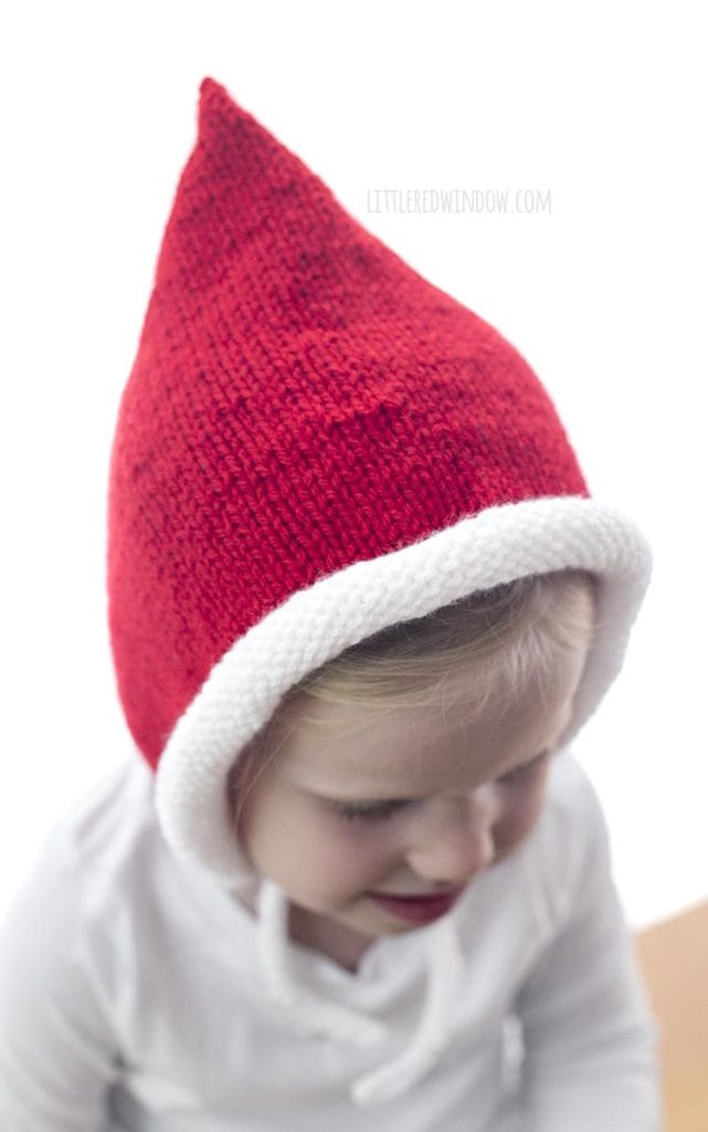 The Santa Pixie Bonnet knitting pattern has a cute white rolled brim!
