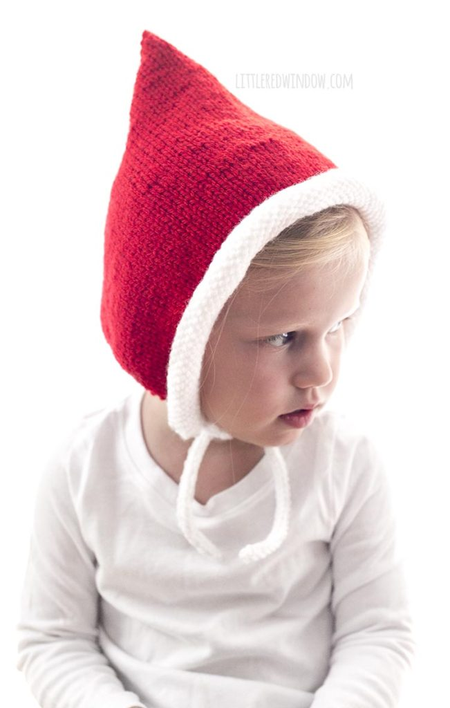 The Santa Pixie Bonnet knitting pattern ties securely under baby's chin!