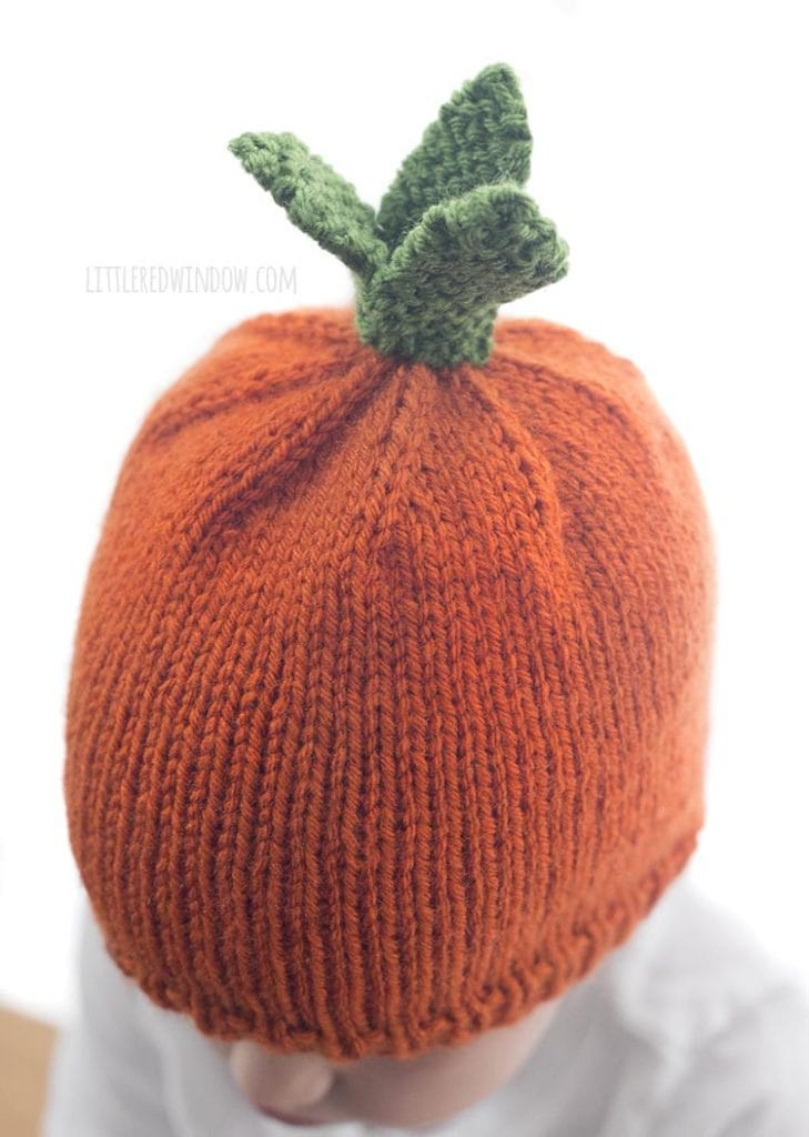 This adorable baby carrot hat knitting pattern includes instructions for three green leaves on top!