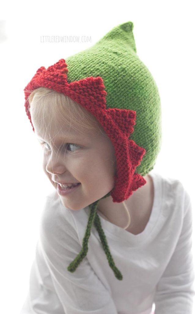 The Elf Pixie Bonnet knitting pattern has a cute pointed top and fun peaked contrast brim!