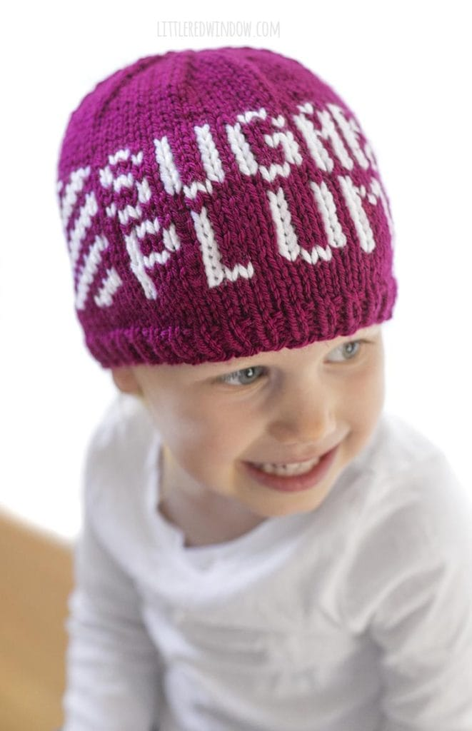 Cute toddler wearing a knit hat that says