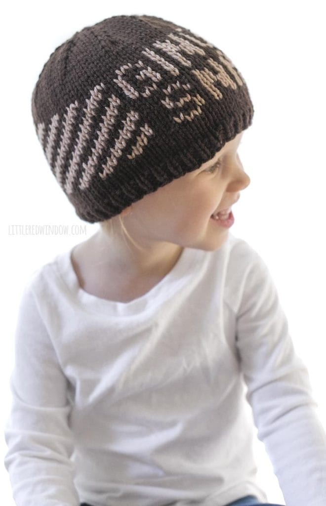 "Adorable toddler wearing a knit hat that says ""Ginger Snap"" on the front!"