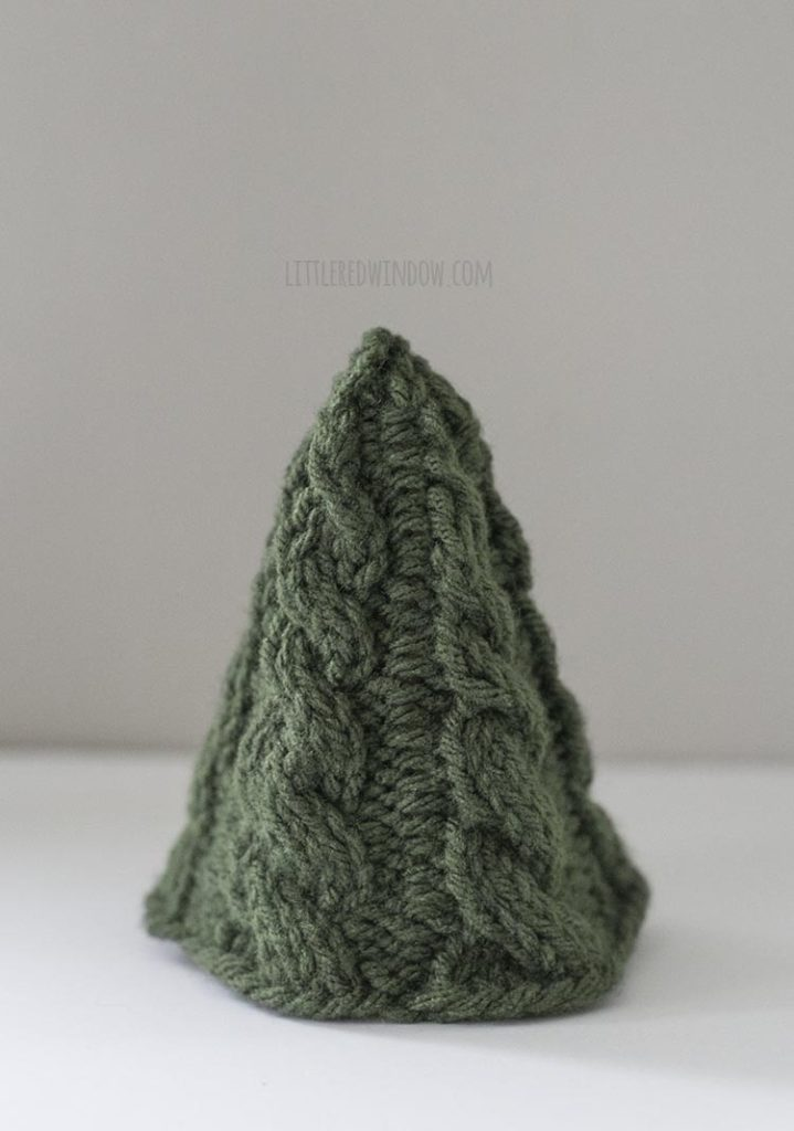 The Small Cozy Christmas tree knitting pattern features a simple twisted cable pattern and it knits up in no time!