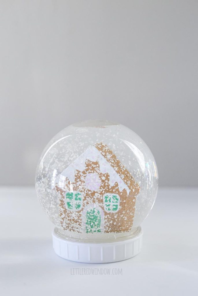 Cute DIY snowman with a gingerbread house inside!