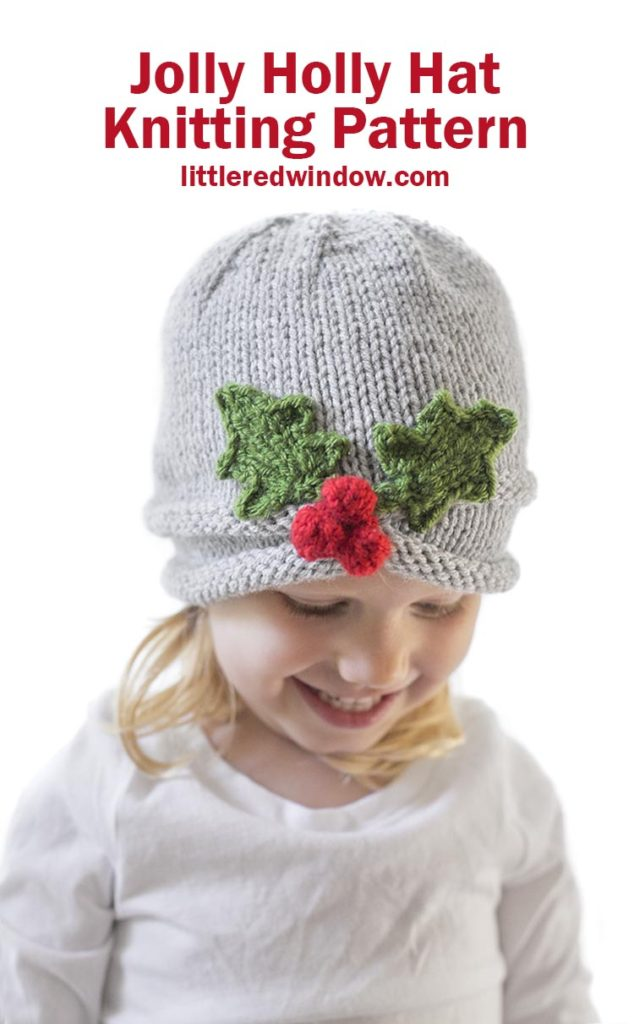 The Jolly Holly Hat knitting pattern is the perfect Christmas baby hat pattern with its sweet gathered brim and cheerful Holly berries!