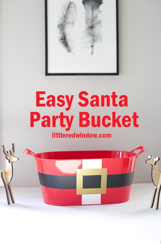Easy Santa Party Bucket, this cute tutorial shows you how to cut vinyl WITHOUT a cutting machine!