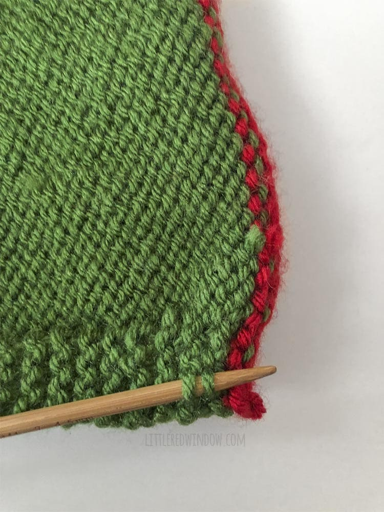 Pick up stitches near the chin of the Elf Pixie Bonnet to knit an icord chin tie!