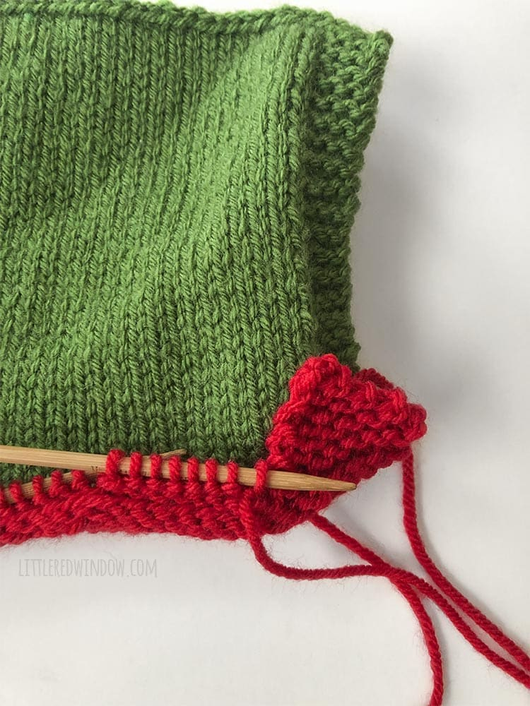 Work with double pointed needles and only 8 stitches at a time to knit the pointed brim of the Elf Pixie Bonnet!