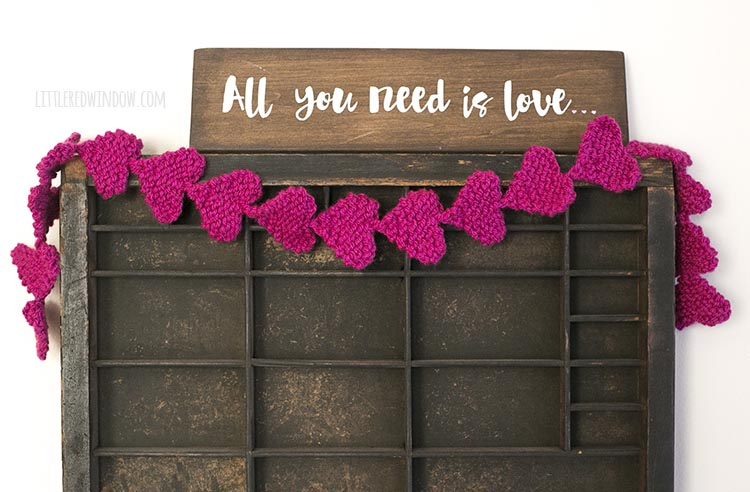 The easy knit heart garland makes an adorable Valentine's Day decoration!