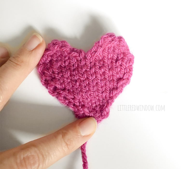 Be sure to block your knit heart shape before sewing it on to your gathered heart hat!