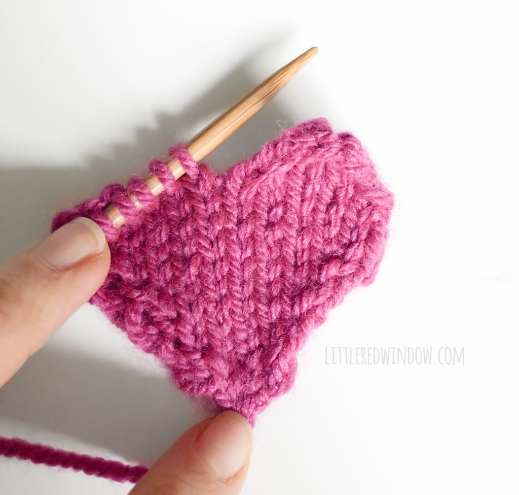 Work with only a few stitches at a time to form the top of the heart shape for the gathered heart hat knitting pattern!