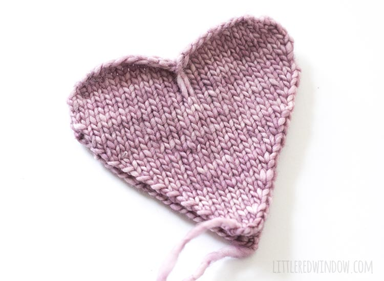 To assemble the heart shaped handwarmer knitting pattern, stack two heart shapes wrong sides together.