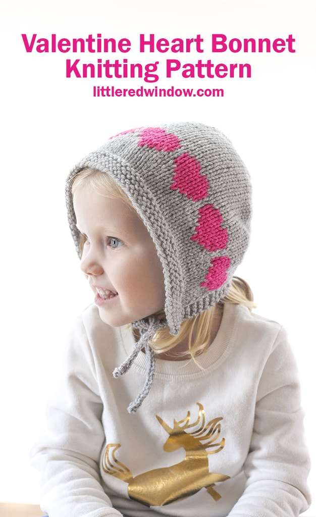 This cute Valentine Heart Bonnet knitting pattern is a quick easy knit for your baby or toddler with bright row of colorwork hearts across the top!