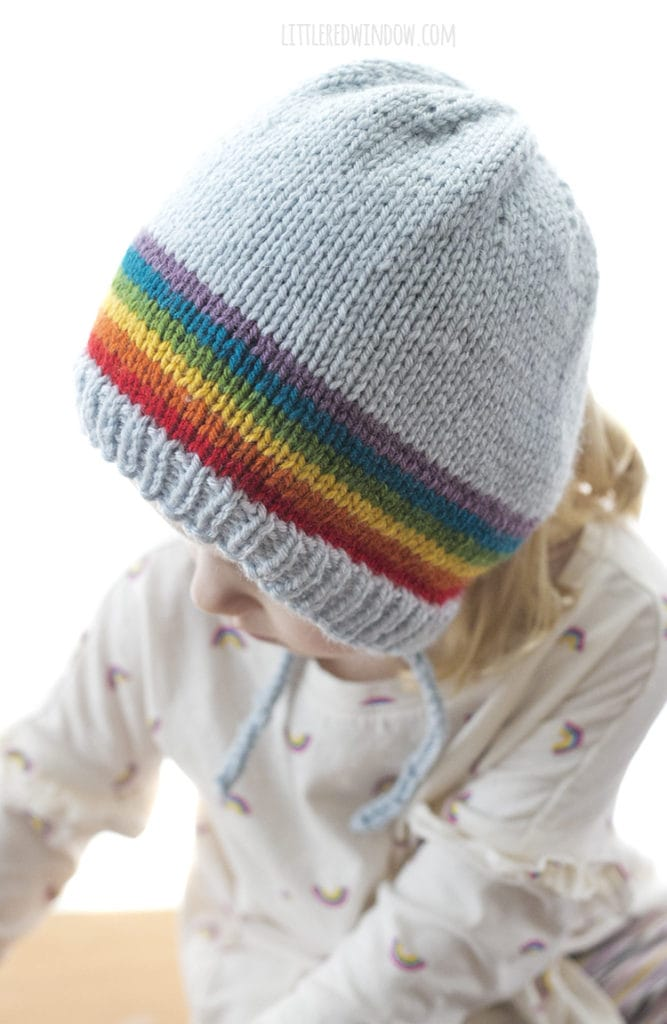 This adorable bonnet has a rainbow stretching across the top from ear to ear!