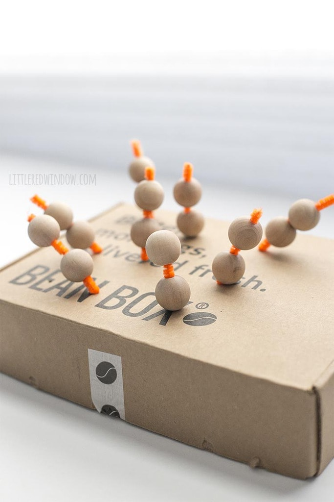 Put your wooden beads on short lengths of pipe cleaner stuck into an old cardboard box to make them easy to paint!
