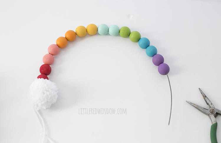 String the rainbow colored wooden beads on wire to make a rainbow shape!